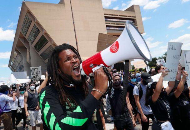 PHOTO: Protesters chant in front of Dallas City Hall in downtown Dallas, Saturday, May 30, 2020. Protests across the country have escalated over the death of George Floyd who died after being restrained by Minneapolis police officers on Memorial Day. (Lm Otero/AP)