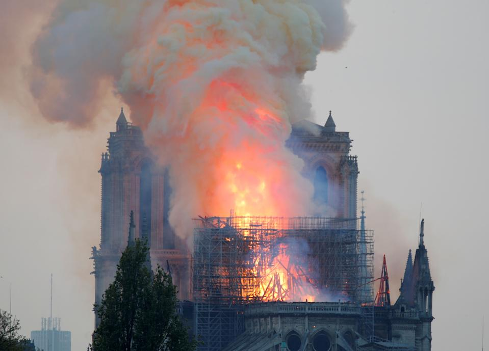 Smoke billows fromNotreDameCathedral after a fire broke out, in Paris, France April 15, 2019. REUTERS/Charles Platiau