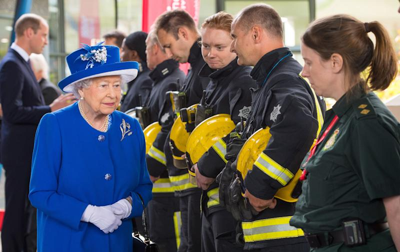 The Queen meets firefighters and paramedics involved in the Grenfell rescue. (PA Wire/PA Images)