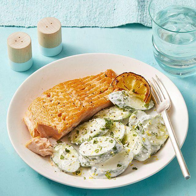 """<p>Heart-healthy salmon gets a Mediterranean-inspired makeover in this good-for-you dinner recipe. Toss cucumber slices in a creamy puree made with plain Greek yogurt, feta, and lemon juice as a satisfying side dish. </p><p><em><a href=""""https://www.womansday.com/food-recipes/food-drinks/a27285989/salmon-with-creamy-feta-cucumbers-recipe/"""" rel=""""nofollow noopener"""" target=""""_blank"""" data-ylk=""""slk:Get the Salmon with Creamy Feta Cucumbers recipe."""" class=""""link rapid-noclick-resp"""">Get the Salmon with Creamy Feta Cucumbers recipe.</a></em></p>"""
