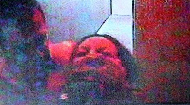 Simon Gittany captured on CCTV dragging Lisa Harnum back into the couple's apartment. Photo: Supplied