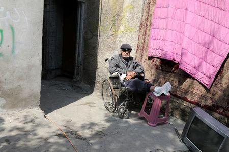 Abdelraziq Abdelkarim sits on a wheelchair as he enjoys the afternoon next to frontline positions of Iraqi Federal Police fighting the Islamic State in Mosul, Iraq