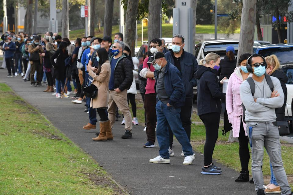 People are seen queued to receive their vaccination at the NSW Vaccine Centre at Homebush Olympic Park in Sydney, Thursday, July 1, 2021.