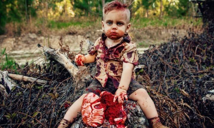 A mum has faces backlash after celebrating her son's first birthday with this zombie cake smash photoshoot. Photo: Amanda Queen Photography