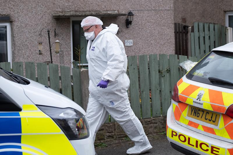 """Police and forensics at a house in Barnsley, March 30 2020. A man has been arrested on suspicion of murder after police were called to an address in Barnsley yesterday. See SWNS story SWLEmurder. A man has been arrested on suspicion of murder after a woman in her 30s was found stabbed to death at a house in a quiet village. South Yorkshire Police say officers were called to an address in Middlecliffe at 5pm yesterday (Sun) over """"concerns for someone's safety"""". When they arrived the victim, aged 31, was found with stab wounds. An air ambulance was spotted landing in a nearby field and paramedics rushed to the property but the injured woman was pronounced dead at the scene. A 40-year-old man has been arrested on suspicion of murder and remains in police custody this morning. The victim has been named locally as NHS worker and mum-of-three Victoria Charlotte Woodhall. A friend of her family confirmed Mrs Woodhall was working as an Operating Department Practitioner for the NHS."""