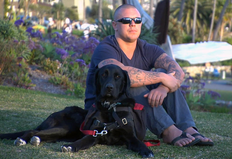 """In this February 2012 photo released by ShelterMe.com showing a photo of Andrew J. Trotto with his dog Teka during the documentary """"Shelter Me."""" in Laguna Beach, Calif. Summer television used to mean reruns. This year it looks like it will be the season of dogs in trouble and troubled dogs. Several shows, network and cable, old and new, series and not, star dogs and their owners who need help. (AP Photo/Steven Latham/ShelterMe.com)"""