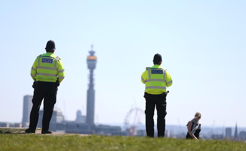 Police officers patrol Primrose Hill, north London, as the UK continues in lockdown to help curb the spread of the coronavirus