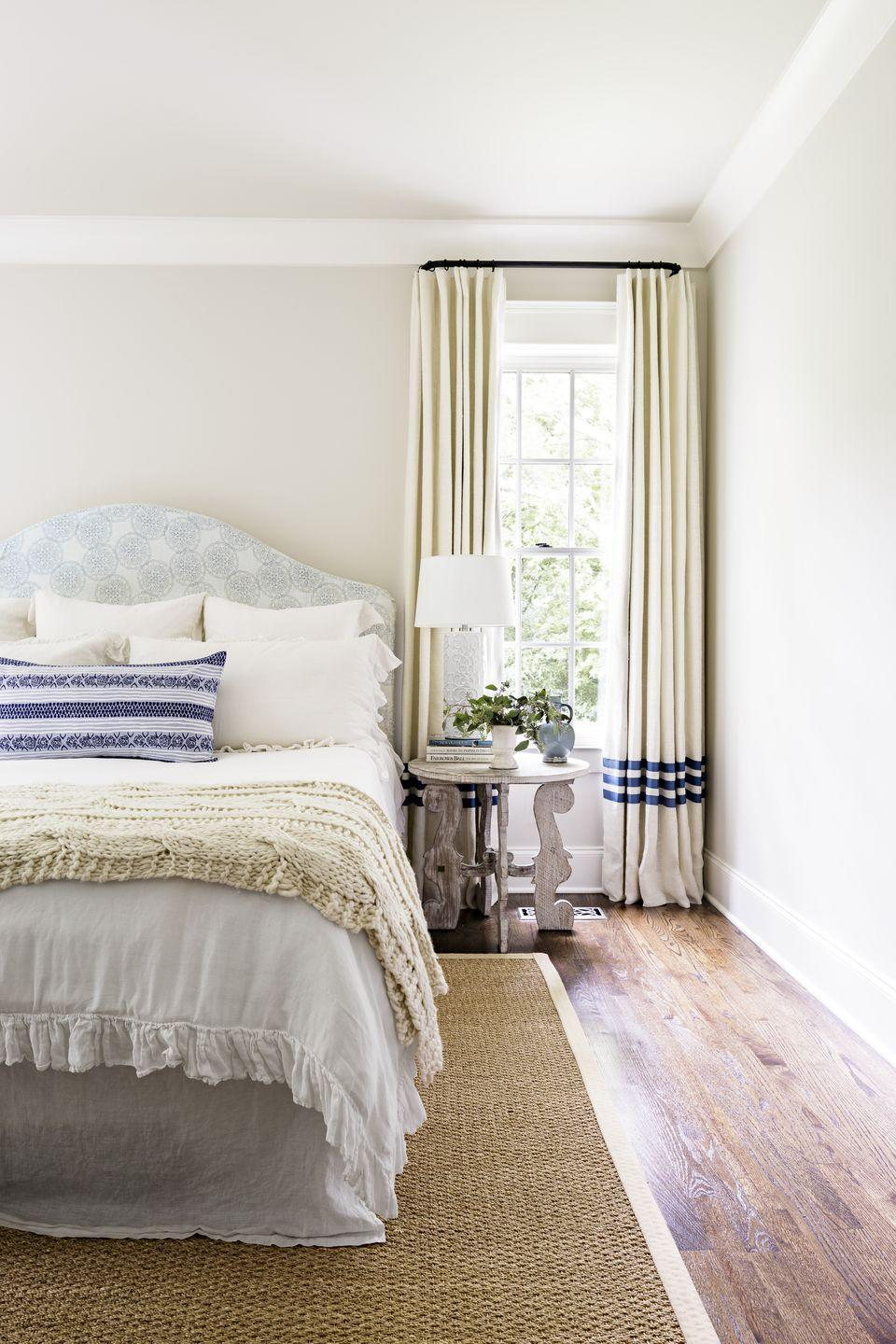 """<p>A soft neutral bedroom provides a calming spot for sleep. For a hint of """"there, but not there"""" color choose a warm off-white for bedroom walls. The soft hue looks great paired with warm white trim (don't go too bright and crisp) as well as a mix of natural materials.</p><p><strong>Get the Look: </strong><br>Wall Paint Color: <a href=""""https://go.redirectingat.com?id=74968X1596630&url=https%3A%2F%2Fwww.homedepot.com%2Fb%2FBEHR%2FSwiss-Coffee%2FN-5yc1vZ3mwZ1z0uoih&sref=https%3A%2F%2Fwww.countryliving.com%2Fremodeling-renovation%2Fhome-makeovers%2Fg32468539%2Fbest-bedroom-paint-colors-ideas%2F"""" rel=""""nofollow noopener"""" target=""""_blank"""" data-ylk=""""slk:Swiss Coffee by Behr"""" class=""""link rapid-noclick-resp"""">Swiss Coffee by Behr</a></p>"""