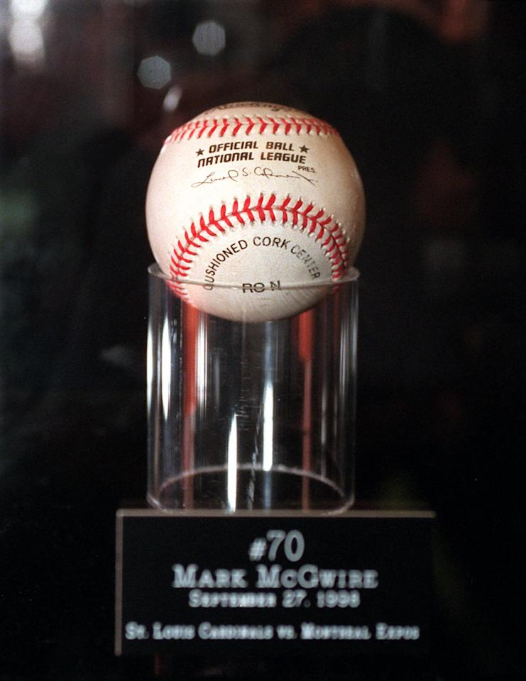 The baseball Mark McGwire hit for home run number 70 is shown at New York's Madison Square Garden Tuesday, Jan. 12, 1999, after it was sold at auction to an undisclosed phone bidder for $2.7 million, plus commission. The previous record for a baseball sold at auction was $126,000, the ball Babe Ruth hit for the first home run in Yankee Stadium. (AP Photo/Ron Frehm)