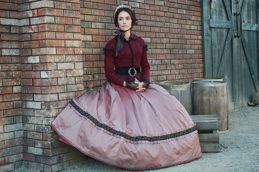 "<p>Lucy's Lincoln-era ballgown ""had a certain impact because the rose and the maroon [represents] what actually happens to her — it's like your heart, blood,"" Mari-An Ceo explains. ""She's been put into this position of high drama."" (Photo by: Sergei Bachlakov/NBC) </p>"