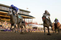 Jockey Luis Saez, left, reacts aboard Essential Quality as they win the Breeders' Cup Juvenile horse race at Keeneland Race Course, Friday, Nov. 6, 2020, in Lexington, Ky. (AP Photo/Darron Cummings)