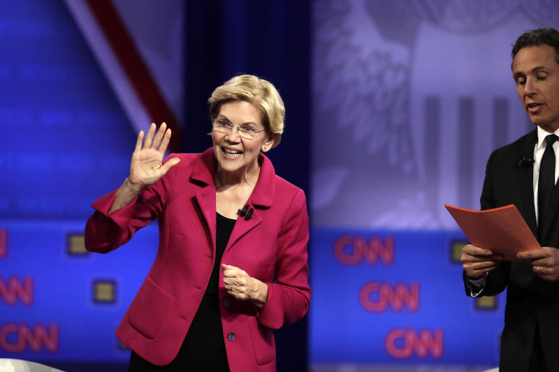 Democratic presidential candidate Sen. Elizabeth Warren, D-Mass., speaks as CNN moderator Chris Cuomo listens during the Power of our Pride Town Hall Thursday, Oct. 10, 2019, in Los Angeles. The LGBTQ-focused town hall featured nine 2020 Democratic presidential candidates. (AP Photo/Marcio Jose Sanchez)
