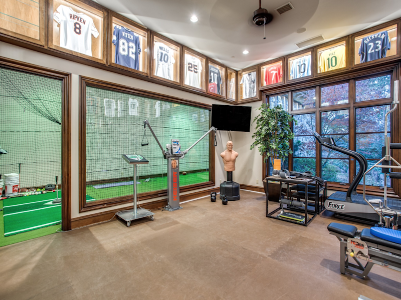 The fitness room and batting cage.