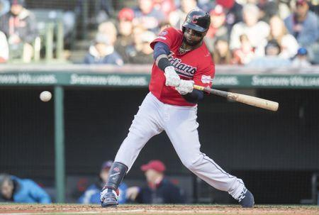 Apr 1, 2019; Cleveland, OH, USA; Cleveland Indians first baseman Carlos Santana (41) hits an RBI single during the sixth inning against the Chicago White Sox at Progressive Field. Mandatory Credit: Ken Blaze-USA TODAY Sports