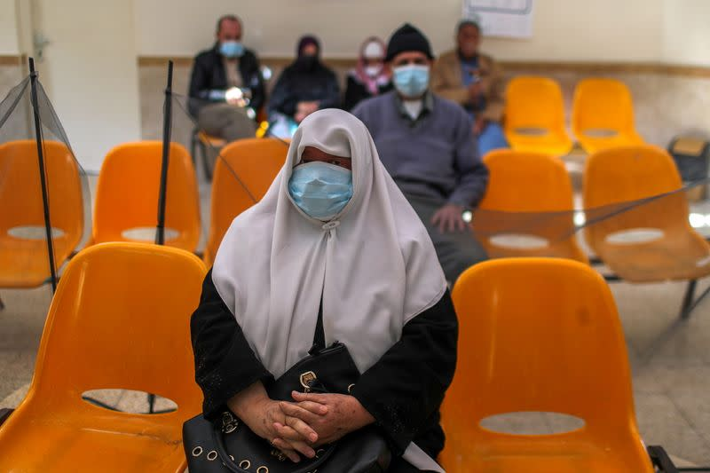 Palestinians wait to be vaccinated against the coronavirus disease (COVID-19), in Gaza City