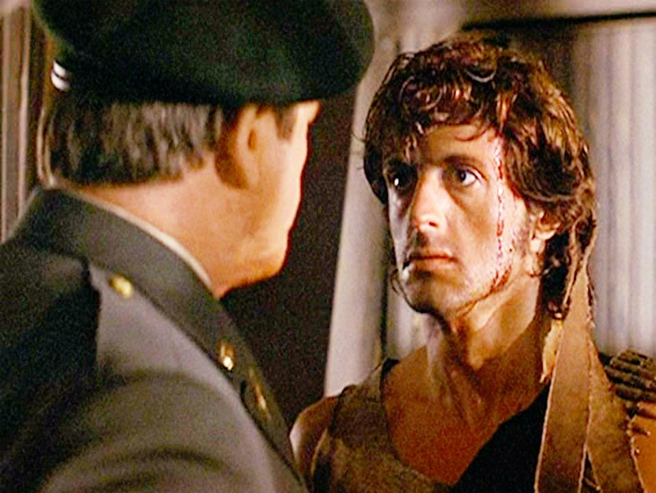 """LOS ANGELES - OCTOBER 2: The movie """"First Blood"""", directed by Ted Kotcheff. (Alternatively referred to as Rambo: First Blood).  Based on David Morrell's novel of the same name.  Seen here from left, Richard Crenna as Colonel Sam Trautman facing John Rambo, (played by Sylvester Stallone).  Initial theatrical release October 2, 1982. Screen capture. Paramount Pictures. (Photo by CBS via Getty Images)"""