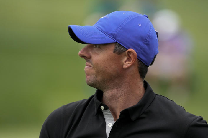 Rory McIlroy, of Northern Ireland watches his tee shot on the 17th hole during the first round of the Masters golf tournament on Thursday, April 8, 2021, in Augusta, Ga. (AP Photo/Charlie Riedel)