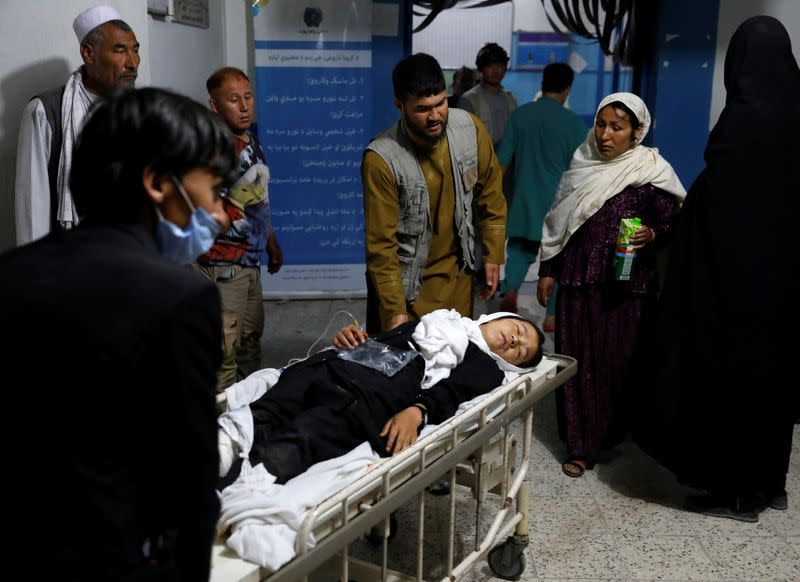 An injured school girl is transported to a hospital after a blast in Kabul