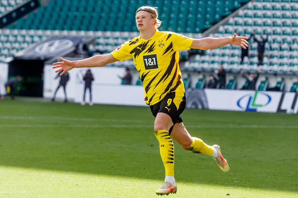 WOLFSBURG, GERMANY - APRIL 24: (BILD ZEITUNG OUT) Erling Haaland of Borussia Dortmund celebrates after scoring his team's second goal during the Bundesliga match between VfL Wolfsburg and Borussia Dortmund at Volkswagen Arena on April 24, 2021 in Wolfsburg, Germany. (Photo by Mario Hommes/DeFodi Images via Getty Images)