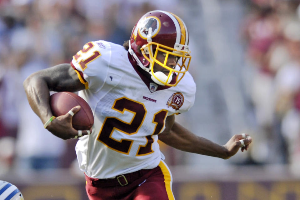 FILE - In this Oct. 7, 2007, file photo, Washington Redskins safety Sean Taylor carries the ball during an NFL football game against the Detroit Lions in Landover, Md. The Washington Football Team plans to retire late safety Sean Taylor's number before its upcoming game against Kansas City. (AP Photo/Nick Wass, File)