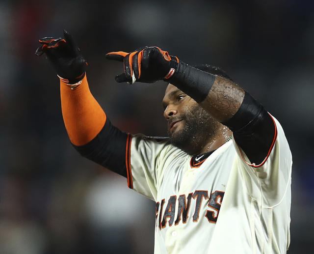 San Francisco Giants' Pablo Sandoval celebrates after making the game-winning hit in the 11th inning of a baseball game against the Chicago Cubs, Monday, July 9, 2018, in San Francisco. The Giants won 2-1. (AP Photo/Ben Margot)