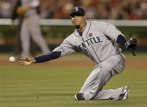 Seattle Mariners starting pitcher Felix Hernandez fails to throw Los Angeles Angels' Alberto Callaspo out at first during the fourth inning of a baseball game in Anaheim, Calif., Thursday, June 20, 2013. (AP Photo/Chris Carlson)