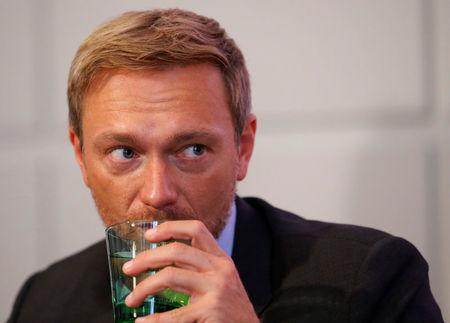 Germany's Free Democratic Party FDP leader Christian Lindner listens during a news conference in Vienna, Austria, October 11, 2017. REUTERS/Heinz-Peter Bader
