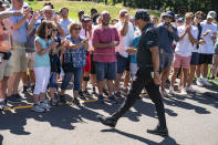 Phil Mickelson greets spectators as he walks to the 12th tee during the first round of the Travelers Championship golf tournament at TPC River Highlands, Thursday, June 24, 2021, in Cromwell, Conn. (AP Photo/John Minchillo)
