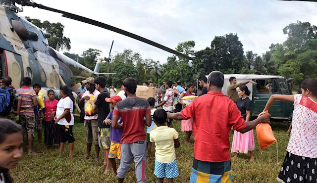 <p>Relief materials are handed out for residents in Ayagama in Ratnapura district, Sri Lanka, Wednesday, May 31, 2017. Sri Lanka's government says the death toll from mudslides and floods has exceeded 200, with dozens missing. (Sri Lanka Air Force via AP) </p>