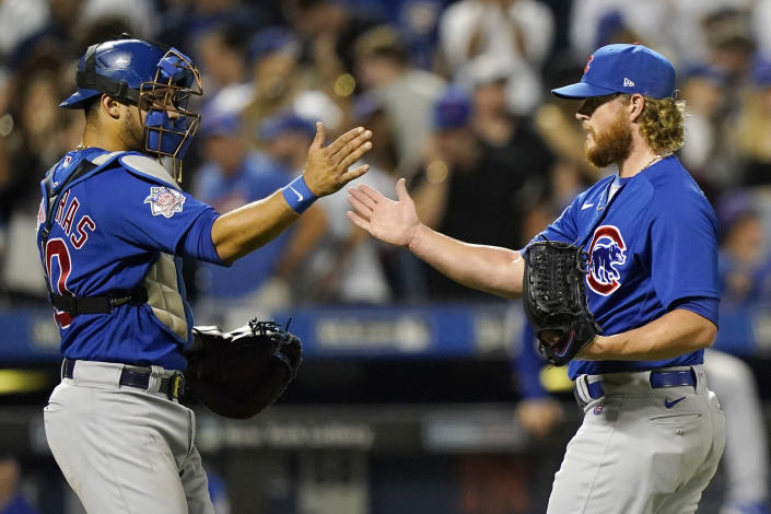 Chicago Cubs catcher Willson Contreras, left, congratulates relief pitcher Craig Kimbrell after they defeated the New York Mets in a baseball game, Thursday, June 17, 2021, in New York. (AP Photo/Kathy Willens)