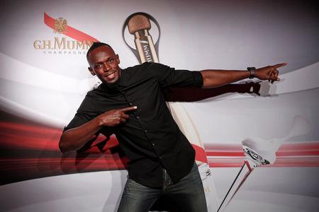 Retired sprinter Usain Bolt gestures as he poses after a zero gravity conditions flight in a specially modified plane above Reims