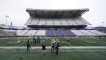 Washington players and coaches take part in NCAA college football practice, Friday, Oct. 16, 2020, at Husky Stadium in Seattle. (AP Photo/Ted S. Warren)
