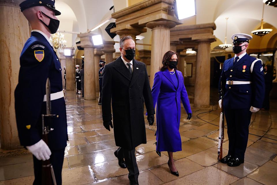 Vice President Kamala Harris arrives at the inauguration with her husband Doug Emhoff. (Photo: JIM LO SCALZO via Getty Images)