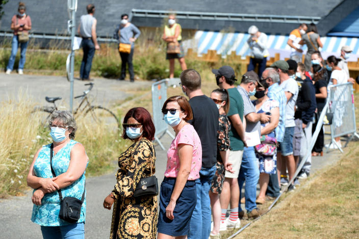 Image: People line up to have a COVID-19 test in Laval, France, as part of a massive testing campaign responding to an outbreak in the area. (Jean-Francois Monier / AFP - Getty Images)