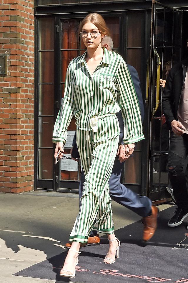 <p>Hadid rocked pajamas designed by Morgan Lane and monogrammed just for her when meeting friends for brunch in April 2017. She didn't just roll out of bed to achieve such an effortless look, though. Check out those stilettos! (Photo: Splash News) </p>
