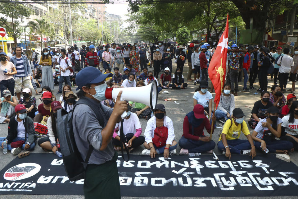 Protesters occupy a street during a rally against the military coup Saturday, March 27, 2021, in Tarmwe township in Yangon, Myanmar. The head of Myanmar's junta on Saturday used the occasion of the country's Armed Forces Day to try to justify the overthrow of the elected government of Aung San Suu Kyi, as protesters marked the holiday by calling for even bigger demonstrations. (AP Photo)