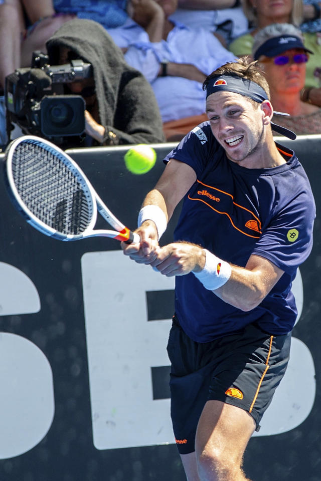 Britain's Cameron Norrie plays a shot against Tennys Sandgren of the U.S. during their singles final match in the ASB Classic at ASB Tennis Arena in Auckland, New Zealand, Saturday, Jan. 12, 2019. (AP Photo/David Rowland)