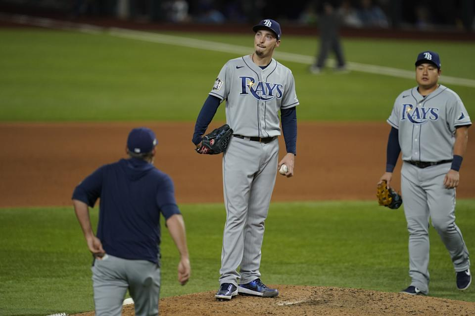 Blake Snell #4 of the Tampa Bay Rays reacts after giving up a hit in the sixth inning of Game 6 of the 2020 World Series between the Los Angeles Dodgers and the Tampa Bay Rays at Globe Life Field on Tuesday, October 27, 2020 in Arlington, Texas. (Photo by Cooper Neill/MLB Photos via Getty Images)