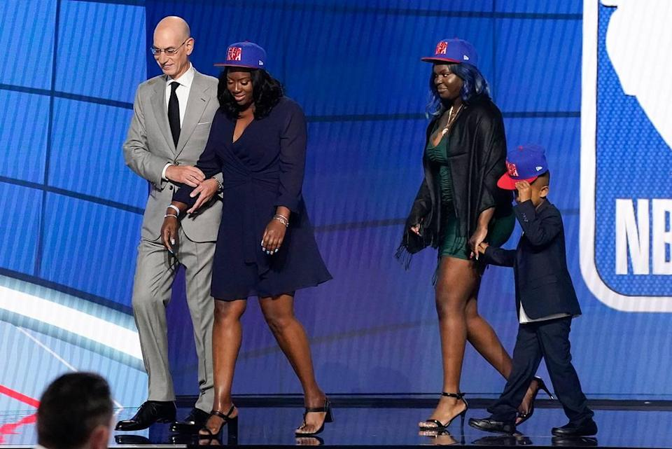 NBA Commissioner Adam Silver escorts relatives of former Kentucky guard Terrence Clarke after a tribute to Clarke during the NBA basketball draft, Thursday, July 29, 2021, in New York. Clarke was killed in a car accident in April 2021.
