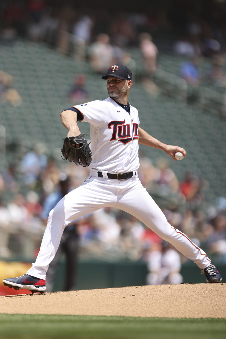 Minnesota Twins pitcher J.A. Happ throws against the Cleveland Indians during the first inning of a baseball game, Sunday, June 27, 2021, in Minneapolis. (AP Photo/Stacy Bengs)