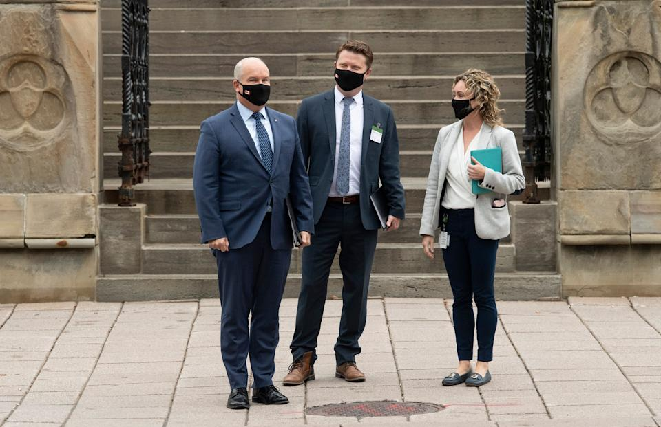 Conservative Leader Erin O'Toole, chief of staff Tausha Michaud and campaign manager Fred DeLorey wait to cross a road as they walk to national caucus, Sept. 9, 2020 in Ottawa. (Photo: THE CANADIAN PRESS/Adrian Wyld)