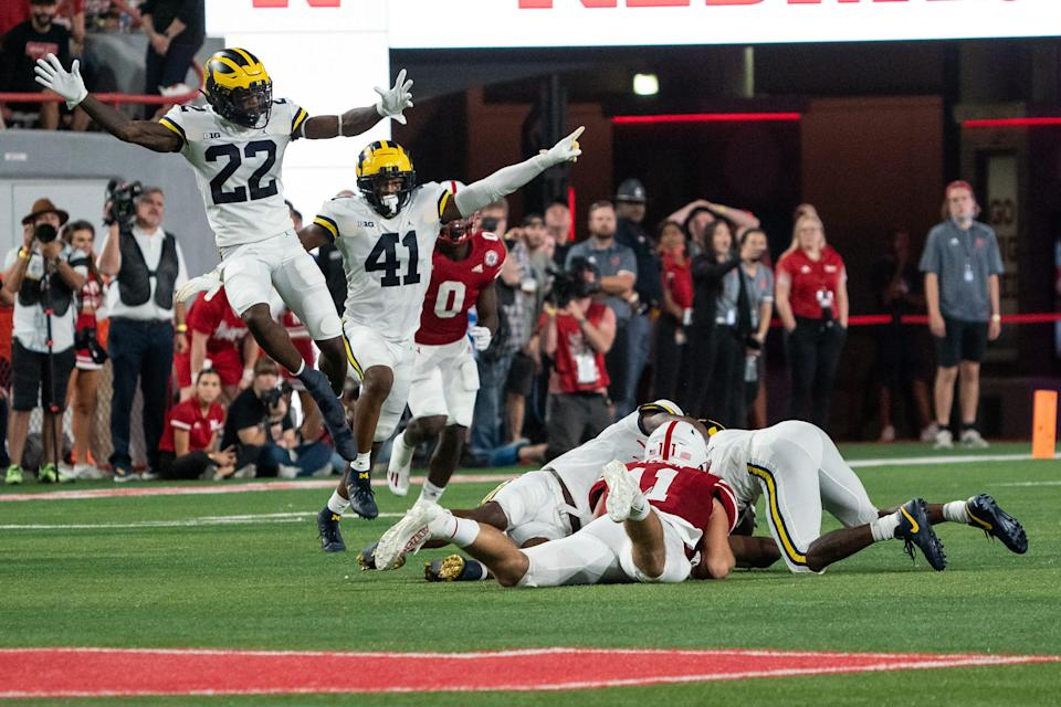 Michigan Wolverines defensive back Gemon Green and linebacker Nikhai Hill-Green celebrate after the Wolverines intercepted a pass from Nebraska Cornhuskers quarterback Adrian Martinez during the second quarter at Memorial Stadium.