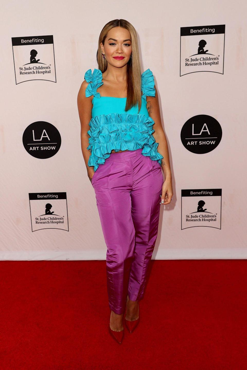 <p>Rita Ora goes colorful on July 29 for the 26th annual L.A. Art Show Opening Night Gala in Los Angeles.</p>