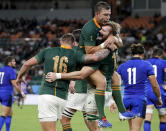 South Africa's RG Snyman is congratulated by teammates Handre Pollard and Malcolm Marx, left, after scoring a try during the Rugby World Cup Pool B game at Shizuoka Stadium Ecopa between South Africa and Italy, in Shizuoka, Japan, Friday, Oct. 4, 2019. (AP Photo/Shuji Kajiyama)