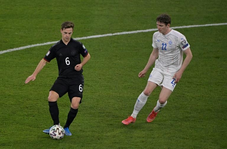 Joshua Kimmich (L) helped create both of Germany's first-half goals against Iceland