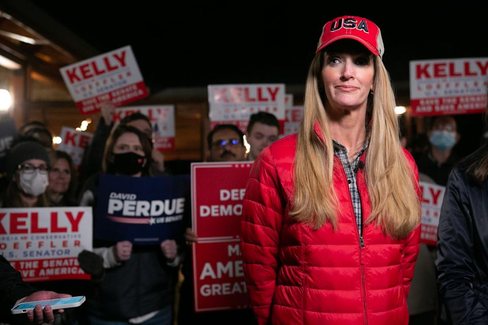 Georgia Republican Senate candidate Kelly Loeffler (R-GA) takes questions from the media during a rally on December 20, 2020 in Cumming, Georgia. (Photo by Jessica McGowan/Getty Images)