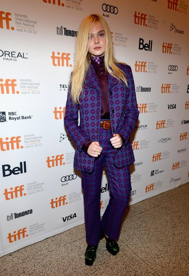 """WORST: Ella Fanning went for a Willy Wonka-esque pantsuit from Miu Miu at the premiere of her new movie, """"Ginger & Rose."""" We admire the 14-year-old for choosing something unusual and risky, but ultimately, this outfit is hard to look at."""