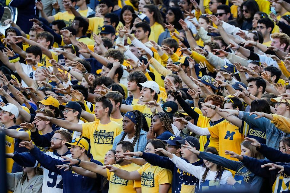 Michigan student section cheer against Rutgers during the second half at Michigan Stadium in Ann Arbor on Saturday, Sept. 25, 2021.