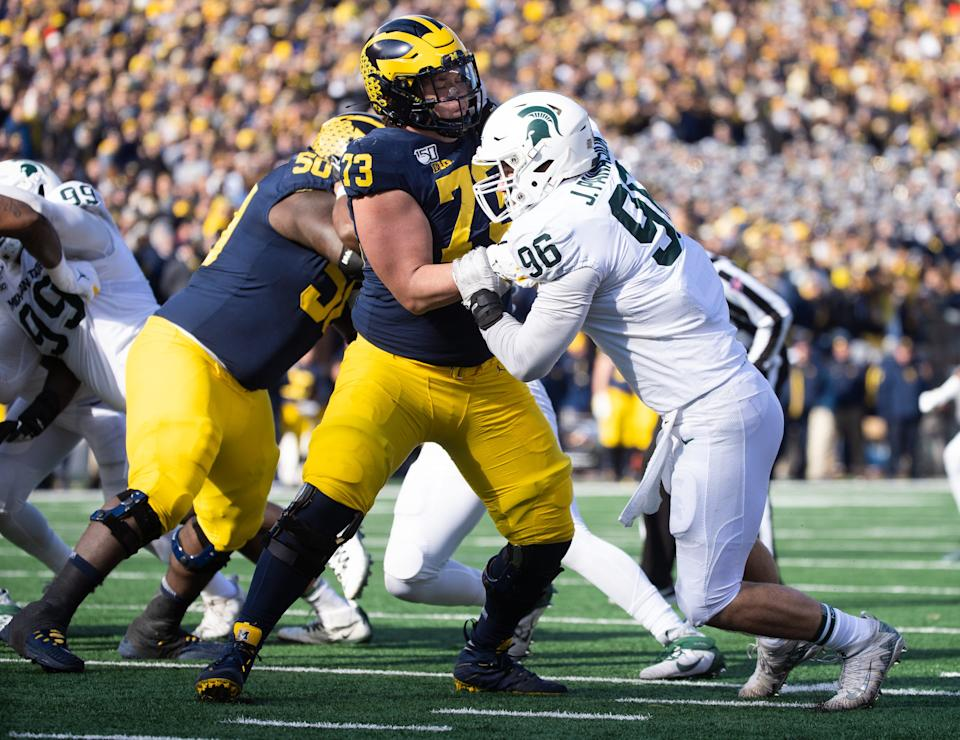 Michigan State defensive end Jacub Panasiuk tries to get past Michigan right tackle Jalen Mayfield at Michigan Stadium in Ann Arbor on Nov. 16, 2019.