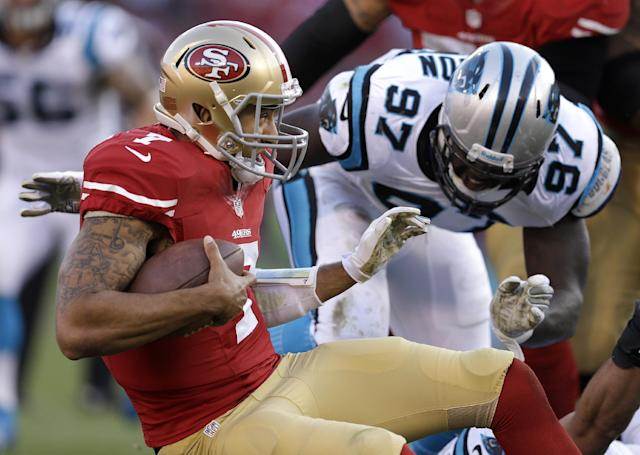 Carolina Panthers defensive end Mario Addison (97) closes in on San Francisco 49ers quarterback Colin Kaepernick (7) during the fourth quarter of an NFL football game in San Francisco, Sunday, Nov. 10, 2013. (AP Photo/Ben Margot)